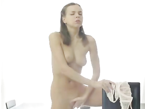 White Lingerie Beauty Undresses And Has Some Fun